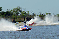 Frame 6: Terry Rinker (#10) and Chris Fairchild (#62) race up the back stright to turn 2 where Rinker's boat rolls over a wake, noses in and flips.   (Formula 1/F1/Champ class)