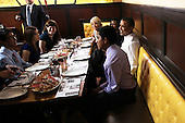 United States President Barack Obama (R) chats with campaign volunteers during a lunch August 10, 2011 at Ted's Bulletin in Washington, DC. Obama had lunch with campaign volunteers who were selected based on essays they wrote about organizing. .Credit: Alex Wong / Pool via CNP