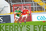 David O'Callaghan of Kerry breaks away from Cork's Sean Kiely last Wednesday night in Pairc Ui Chaoimh, Cork in the Munster GAA Junior Football Championship.