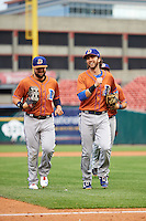 Durham Bulls Jaff Decker (left) and Nick Franklin (right) jog off the field in between innings during a game against the Buffalo Bisons on June 13, 2016 at Coca-Cola Field in Buffalo, New York.  Durham defeated Buffalo 5-0.  (Mike Janes/Four Seam Images)