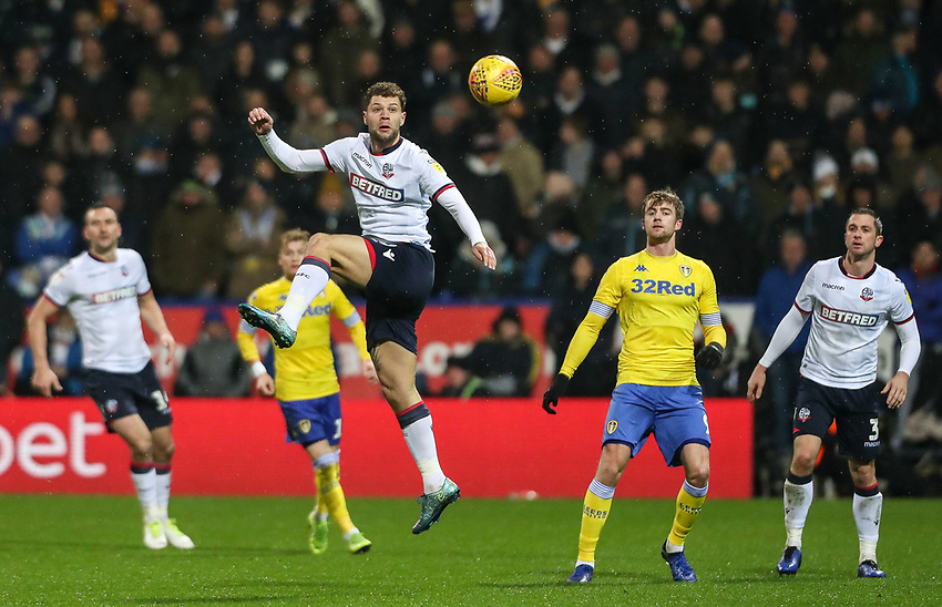 Bolton Wanderers' Yanic Wildschut heads clear in defence <br /> <br /> Photographer Andrew Kearns/CameraSport<br /> <br /> The EFL Sky Bet Championship - Bolton Wanderers v Leeds United - Saturday 15th December 2018 - University of Bolton Stadium - Bolton<br /> <br /> World Copyright © 2018 CameraSport. All rights reserved. 43 Linden Ave. Countesthorpe. Leicester. England. LE8 5PG - Tel: +44 (0) 116 277 4147 - admin@camerasport.com - www.camerasport.com