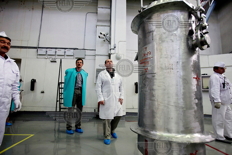 American-Ukrainian physicist Igor Bolshinsky (in green cape) inspects the transfer of highly enriched uranium (HEU) into casks at the Institute of Nuclear Physics in Almaty. The removal of Kazakhstan's HEU is part of the U.S. Global Threat Reduction Initiative (GTRI), where Bolshinsky works, which tries to secure nuclear material around the world to prevent their misuse.