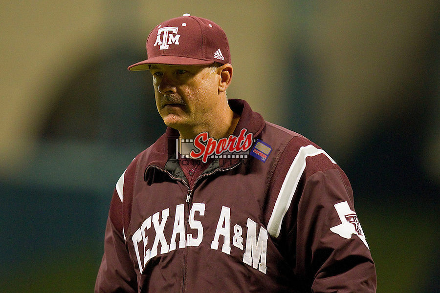 Texas A&M Aggies head coach Rob Childress #29 walks off the field after talking to his pitcher during the game against the Rice Owls at Minute Maid Park on March 5, 2011 in Houston, Texas.  Photo by Brian Westerholt / Four Seam Images
