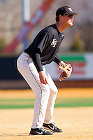 Third baseman Joe Napolitano #12 of the Wake Forest Demon Deacons on defense during an intrasquad game at Wake Forest Baseball Park on January 29, 2012 in Winston-Salem, North Carolina.  (Brian Westerholt / Four Seam Images)