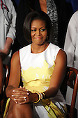 United States First Lady Michelle Obama attends an event about the Affordable Care Act at George Washington University Hospital, on Wednesday, July 14, 2010, in Washington, DC. .Credit: Leslie E. Kossoff - Pool via CNP