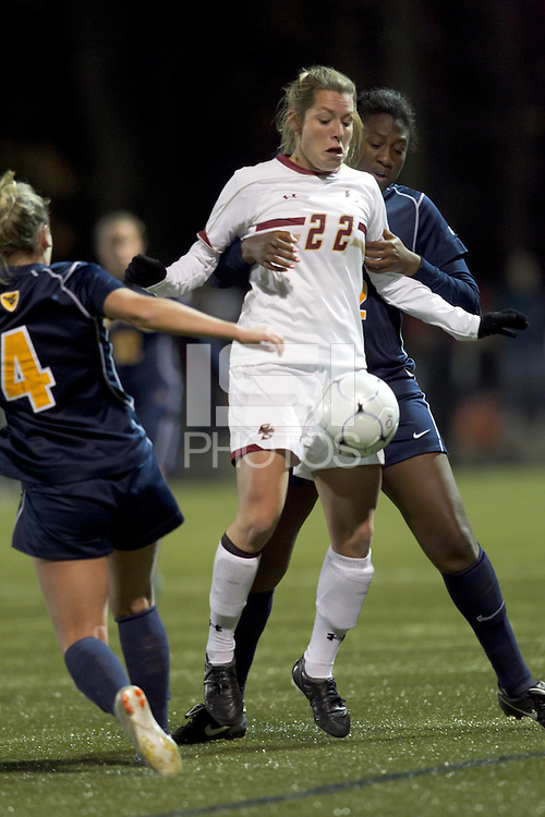 """Boston College forward Stephanie Wirth (22) traps the ball as West Virginia defender Mallory Smith (22) defends. Boston College defeated West Virginia, 4-0, in NCAA tournament """"Sweet 16"""" match at Newton Soccer Field, Newton, MA."""