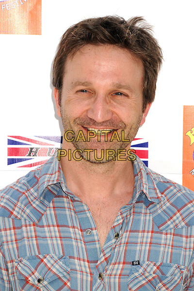 Breckin Meyer.6th Annual Kidstock Music and Art Festival held at Greystone Mansion, West Hollywood, California USA..3rd June 2012.headshot portrait red white stubble facial hair blue check shirt smiling .CAP/ADM/BP.©Byron Purvis/AdMedia/Capital Pictures.