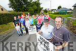 Mike Dennehy and Aidan Linnane (Foreground) with locals in the Finuge area protesting at the proposed windfarm in the area.