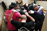 The Haskins team huddle in the dressing room during a Boxing Show at Whitchurch Leisure Centre on 5th October 2019. Lee Haskins and his son Anton Haskins both appeared on the same card, Anton making his professional debut.