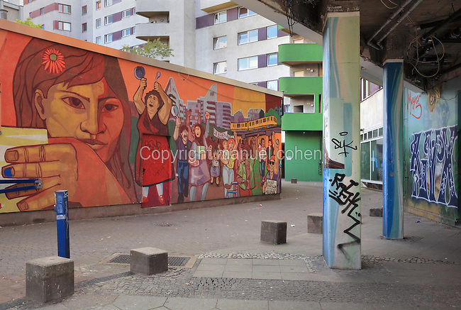 Apartment buildings and graffiti and street art near the Kottbusser Tor U-Bahn station or underground train station, in Kreuzberg, Berlin, Germany. Picture by Manuel Cohen