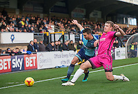 Scott Harrison of Hartlepool United tackles Matt Bloomfield of Wycombe Wanderers during the Sky Bet League 2 match between Wycombe Wanderers and Hartlepool United at Adams Park, High Wycombe, England on 26 November 2016. Photo by Andy Rowland.