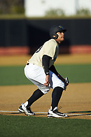 Christian Long (19) of the Wake Forest Demon Deacons takes his lead off of third base against the Gardner-Webb Runnin' Bulldogs at David F. Couch Ballpark on February 18, 2018 in  Winston-Salem, North Carolina. The Demon Deacons defeated the Runnin' Bulldogs 8-4 in game one of a double-header.  (Brian Westerholt/Four Seam Images)