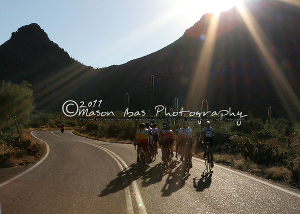 Riders approach the Tucson Mountains at sunrise during the Tucson Bicycle Classic.