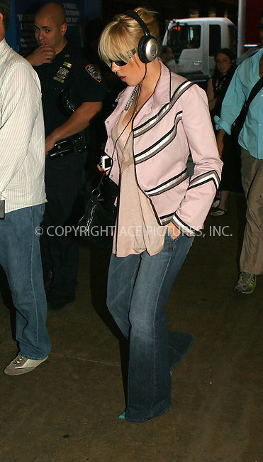 WWW.ACEPIXS.COM . . . . .  ....NEW YORK, JULY 11, 2005....Scarlett Johansson seen leaving her midtown hotel to head to TRL to promote her new movie 'The Island.'....Please byline: PAUL CUNNINGHAM - ACE PICTURES..... *** ***..Ace Pictures, Inc:  ..Craig Ashby (212) 243-8787..e-mail: picturedesk@acepixs.com..web: http://www.acepixs.com