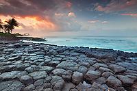 Basltic columns (columnar jointing) and sunrise, Poipu. Kauai, Hawaii.