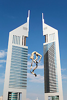 United Arab Emirates, Dubai: The Emirates Towers and sculpture of tight rope walker