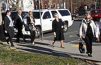 CHARLOTTESVILLE, VA - FEBRUARY 13: Yeardley Love's mother Sharon Love, right, is escorted with family members to the Charlottesville Circuit courthouse for the George Huguely trial. Huguely was charged in the May 2010 death of his girlfriend Yeardley Love. She was a member of the Virginia women's lacrosse team. Huguely pleaded not guilty to first-degree murder. (Credit Image: © Andrew Shurtleff