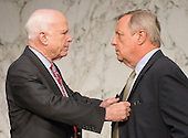 """United States Senator John McCain (Republican of Arizona), left, and U.S. Senator Dick Durbin (Democrat of Illinois), right, confer prior to the U.S. Senate Foreign Relations Committee hearing on """"Authorization of Use of Force in Syria"""" on Capitol Hill in Washington, D.C. on Tuesday, September 3, 2013.<br /> Credit: Ron Sachs / CNP"""
