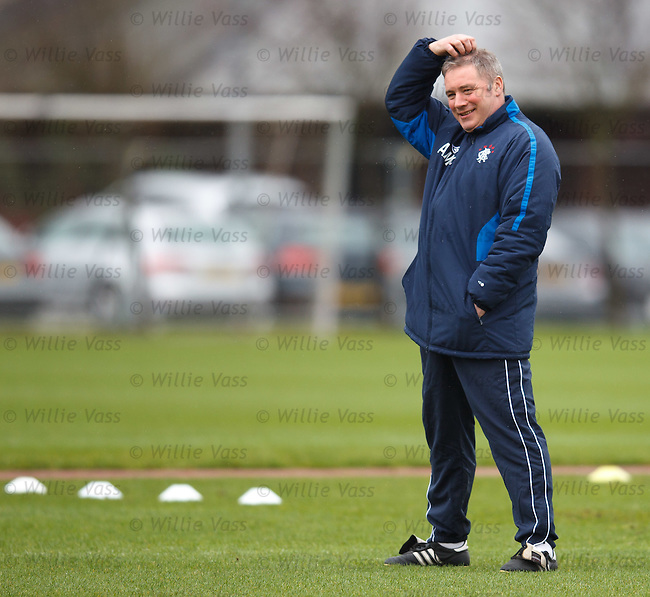 Ally McCoist watches his players go through their paces