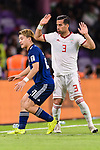 Doan Ritsu of Japan (L) fights for the ball with Ehsan Haji Safi of Iran (R) during the AFC Asian Cup UAE 2019 Semi Finals match between I.R. Iran (IRN) and Japan (JPN) at Hazza Bin Zayed Stadium  on 28 January 2019 in Al Alin, United Arab Emirates. Photo by Marcio Rodrigo Machado / Power Sport Images