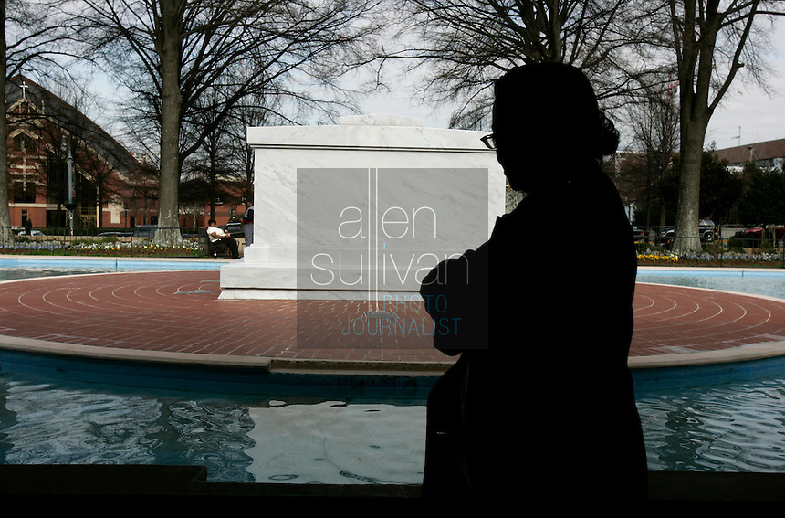 Stephanie Cain, of Rock Hill, S.C., visits the tomb of Dr. Martin Luther King Jr. and his wife, Coretta Scott King, at the Martin Luther King Jr. National Historic Site.<br />