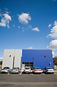 A full length view of the west side of IDeAs green office building, blue sky. San Jose, California, USA