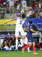 ARLINGTON, TEXAS - Saturday July 22, 2017: Omar Gonzalez #3 of USMNT defends the ball from the Costa Rican National Team in the first half of the match at AT&T Stadium.
