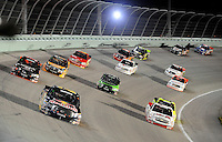 Nov. 14, 2008; Homestead, FL, USA; NASCAR Craftsman Truck Series driver Scott Speed (22) leads a pack of racers during the Ford 200 at Homestead Miami Speedway. Mandatory Credit: Mark J. Rebilas-