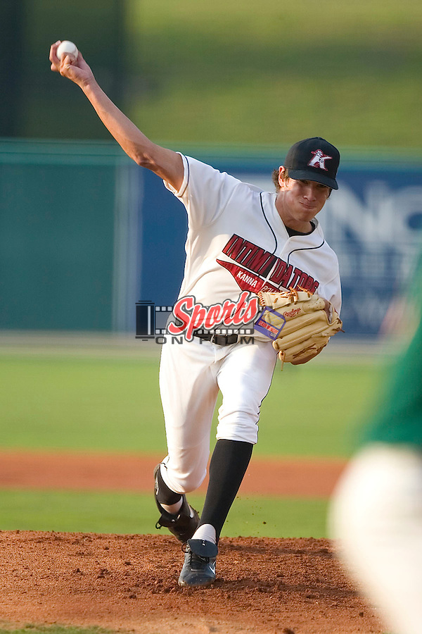 Kannapolis Intimidators pitcher Daniel Cortes winds up to deliver the ball to the plate versus the Greensboro Grasshoppers at Fieldcrest Cannon Stadium in Kannapolis, NC, Friday, June 30, 2006.