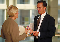 Man and woman discussing business. Focus on man. Professionals. Lawyers. Businessman. Denver Colorado USA.