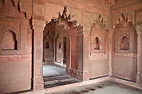 Fatehpur Sikri, Uttar Pradesh, India.   Hindu and Islamic Architectural Influences in Birbal's Palace, Residence of the Emperor's Senior Wives.  Corbelled Arches, Floral Wall Designs.  Islamic Geometric Designs, Islamic Arches in Wall Niches.