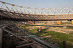Indian workers at the Jawarhalal Nerhu Stadium which is the main venue for the New Delhi Commonwealth Games 2010. The various stadiums completion date are running behind schedule and organisers are worried about having the venues ready in time for the Games.