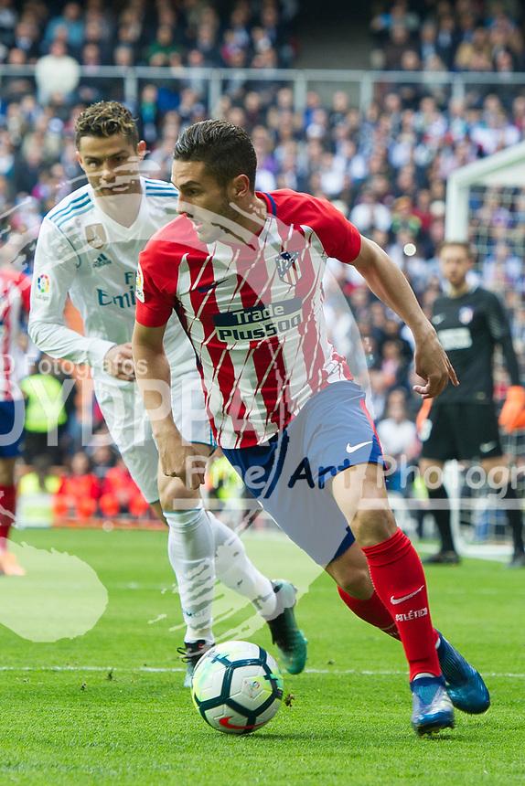 Atletico Madrid's Spanish midfielder Koke; Real Madrid's Portuguese forward Cristiano Ronaldo<br /> Spanish league football match Real Madrid vs Atletico de Madrid at the Santiago Bernabeu stadium in Madrid on April 8, 2018.
