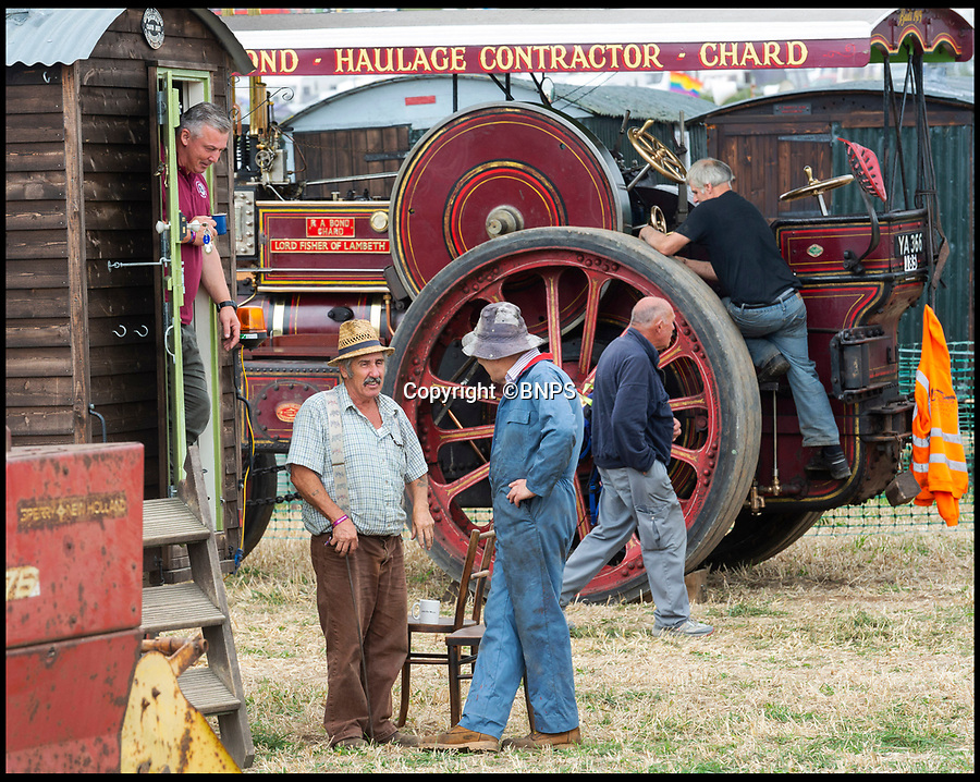 BNPS.co.uk (01202 558833)Pic: RogerArbon/BNPS<br /> <br /> Steam engine enthusiasts prepare their machines at the Great Dorset Steam Fair.<br /> <br /> World's largest steam fair opens in Dorset.<br /> <br /> The 50th Dorset Steam Fair looks like a travelling army on the fields outside Blandford in Dorset. <br /> <br /> The huge celebration of all things steam powered now covers a massive 700 acre site with over 500 steam engines, WW1 trenches, a Victorian  funfair, and even a locomotive on freshly laid track.<br /> <br /> One of the main challenges for the 250,000 visitors is finding their way back to their cars or campervans at the end of the day.
