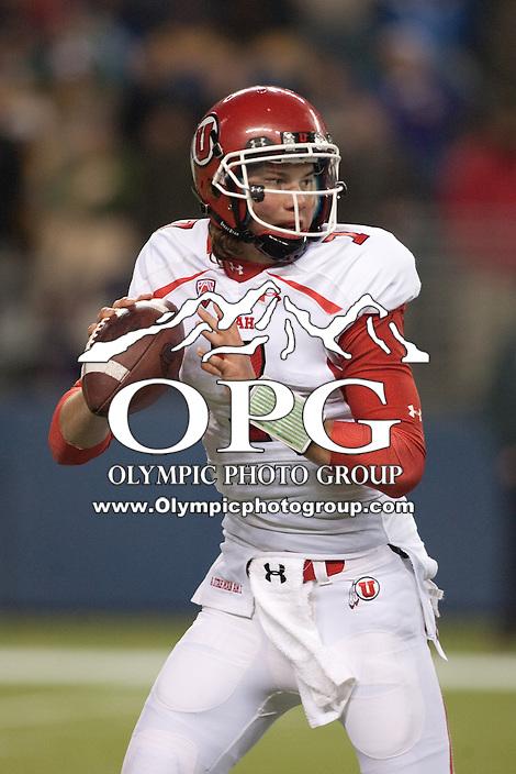 NOV 10, 2012: Utah quarterback #7 Travis Wilson looks down field against Washington.  Washington won 34-15 over Utah at CenturyLink Field in Seattle, WA...