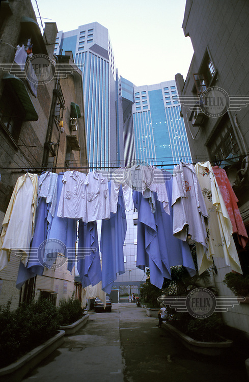 Laundry hanging out to dry in an old hutong quarter which is being rapidly demolished to make way for modern high-rise buildings.
