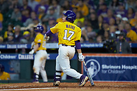 Zack Mathis (17) of the LSU Tigers follows through on his swing against the Oklahoma Sooners in game seven of the 2020 Shriners Hospitals for Children College Classic at Minute Maid Park on March 1, 2020 in Houston, Texas. The Sooners defeated the Tigers 1-0. (Brian Westerholt/Four Seam Images)