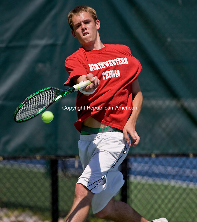 LAKEVILLE, CT - 21 MAY 2010 -052110JT09-<br /> Northwestern's Matt Dunlop returns the ball to Thomaston's Pat Capobianco during Friday's Berkshire League Tennis Championship at the Hotchkiss School in Lakeville.<br /> Josalee Thrift Republican-American