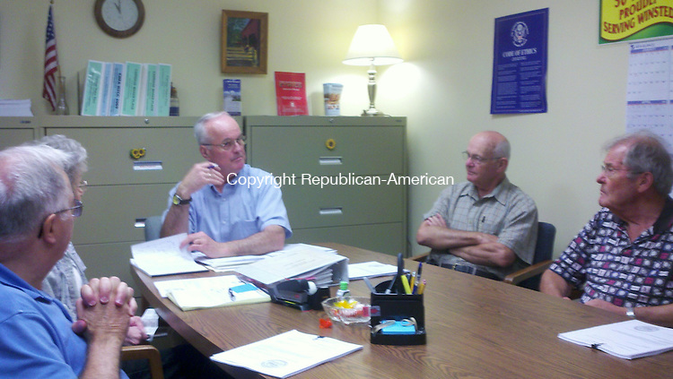 WINSTED, CT - 08 Aug. 2012 - 080812KM01 - Winchester Housing Authority Executive Director Fred W. Newman (center) addresses members of the authority at a meeting Wednesday regarding a federal discrimination lawsuit against the authority. Kurt Moffett Republican-American