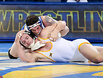 BROOKINGS, SD - JANUARY 18: Nate Rotert from South Dakota State University has control of Cody Vigoren from Wyoming during their 197 pound match Thursday night at Frost Arena in Brookings. (Photo by Dave Eggen/Inertia)