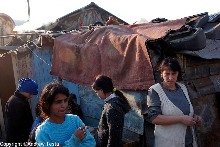 KOSOVO. Zvecan.28th January 2006..A Roam family in one of the Roma camps near Zvecan.  A slag heap of toxic waste lies directly behind their homes..©Andrew Testa for the New York Times