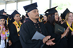 Willie Jim applauds during the 2015 Western Nevada College Commencement held at the Pony Express Pavilion in Carson City, Nev., on Monday, May 18, 2015.<br /> Photo by Tim Dunn