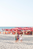 ISRAEL, Tel Aviv, Four people are walking at the beach