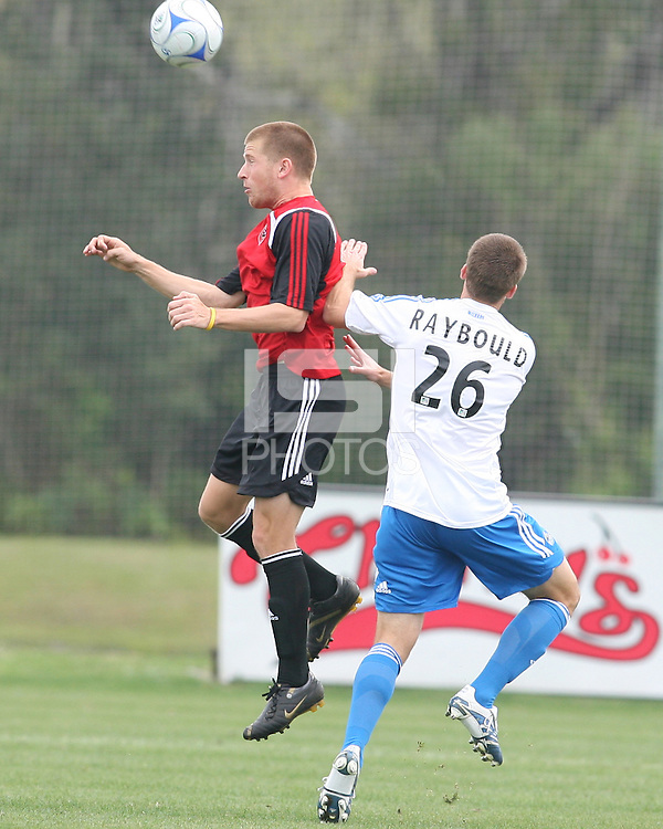 Ryan Cordeiro of DC United heads the ball away from Ryan Raybould 26 of the Wizards. Kansas City Wizards tied DC United 1-1 in a friendly pre-season game in Bradenton, Florida on February 12, 2008.