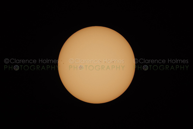 The complete Sun disk is once again visible at the end of the Great American Eclipse on August 21, 2017.  Sunspots are visible on the sun's surface.