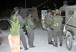 Israeli soldiers surround a neighbourhood during a military operation in the West Bank city of Hebron, early on 22 August 2011. Israel declared all-out war on Hamas, launching air strikes on its Gaza Strip stronghold and putting its leaders in the crosshairs for the creation of a Palestinian state and with the latest Israeli air strikes on Gaza in which 14 people were killed and around 40 wounded, according to Palestinian sources. Photo by Najeh Hashlamoun..