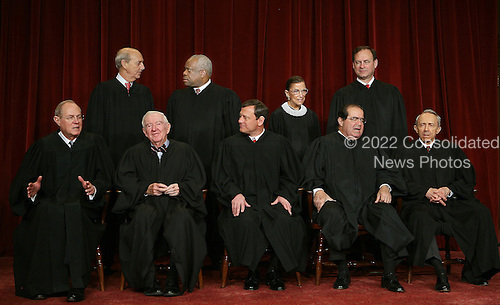 Washington, D.C. - March 3, 2006 -- 2006 Class Portrait of the Justices of the United States Supreme Court taken March 3, 2006, at the United States Supreme Court Building in Washington, D.C.  Seated in the front row, from left to right are: Associate Justice Anthony M. Kennedy, Associate Justice John Paul Stevens, Chief Justice of the United States John G. Roberts, Jr., Associate Justice Antonin Scalia, and Associate Justice David Souter. Standing, from left to right, in the top row, are: Associate Justice Stephen Breyer, Associate Justice Clarence Thomas, Associate Justice Ruth Bader Ginsburg, and Associate Justice Samuel Alito Jr.  Stevens, the longest serving Justice, was nominated by United States President Gerald R. Ford. He took his seat in December 1975.   Alito, the newest Justice, was sworn-in on January 31, 2006. He replaced Sandra Day O'Connor,  the first woman to serve as Associate Justice of the United States  Supreme Court.  .Credit: Pool via CNP