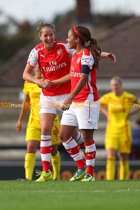 Casey Stoney of Arsenal Ladies (L) celebrates scoring the third goal for her team - Arsenal Ladies vs Liverpool Ladies - FA Womens Super League Football at Meadow Park, Boreham Wood FC  - 05/10/14 - MANDATORY CREDIT: Gavin Ellis/TGSPHOTO - Self billing applies where appropriate - contact@tgsphoto.co.uk - NO UNPAID USE