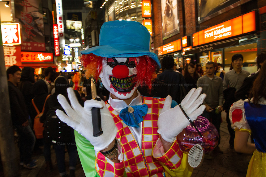 People dressed in clown costumes for Halloween in Shibuya, Tokyo, Japan. Friday October 31st 2014