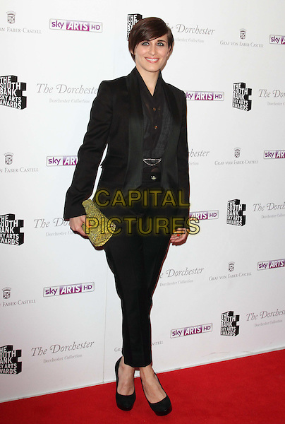 Vicky McClure.South Bank Sky Arts Awards at the Dorchester Hotel, Park Lane, London, England..May 1st 2012.full length black suit green clutch bag.CAP/ROS.©Steve Ross/Capital Pictures
